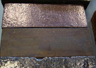 metal on bricks